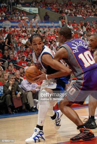 Shaun Livingston of the Los Angeles Clippers moves the ball against Leandro Barbosa of the Phoenix Suns in game four of the Western Conference...