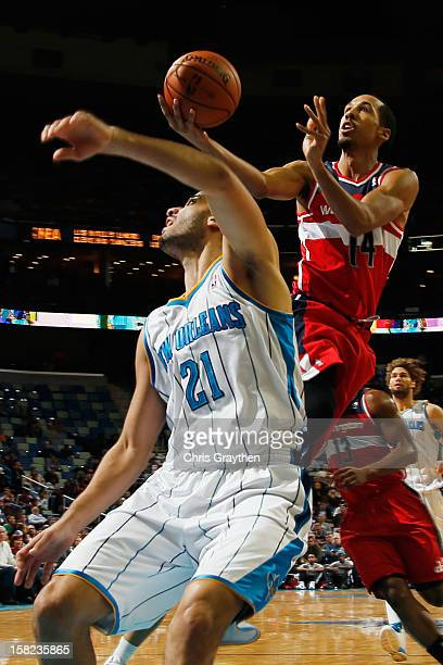 Shaun Livingston of the Washington Wizards shoots the ball over Greivis Vasquez of the New Orleans Hornets at New Orleans Arena on December 11 2012...