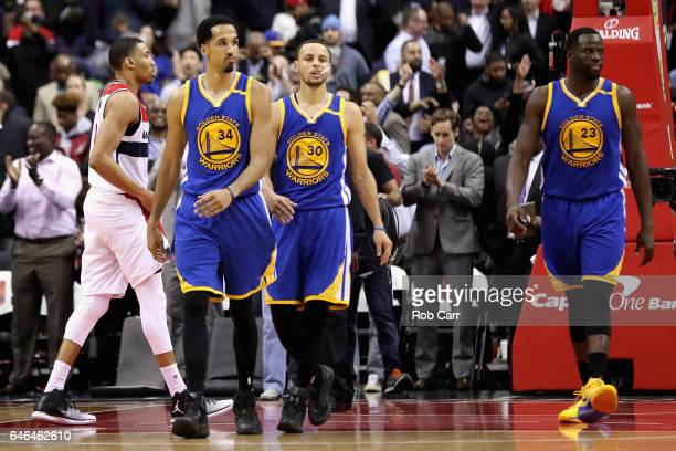 Shaun Livingston Stephen Curry and Draymond Green of the Golden State Warriors walk off the floor after losing 112108 to the Washington Wizards at...