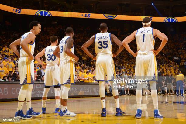 Shaun Livingston Stephen Curry Andre Iguodala Kevin Durant and JaVale McGee of the Golden State Warriors stand on the court in Game Two the Western...