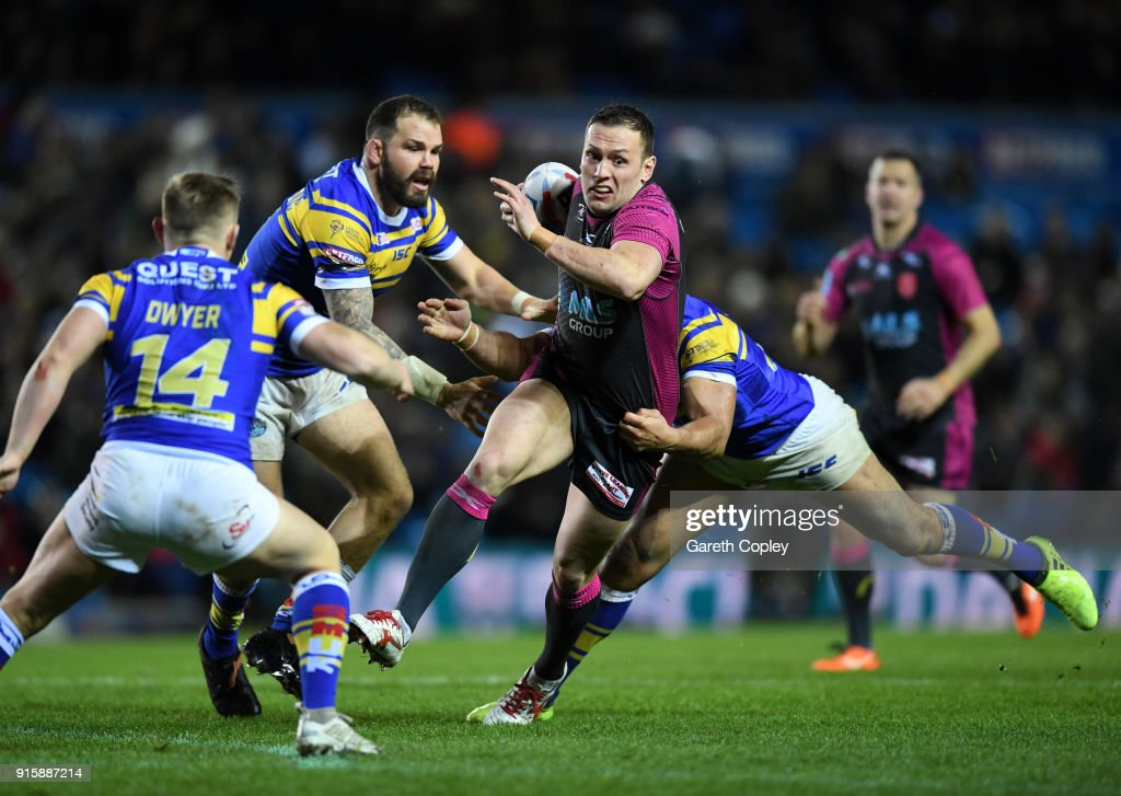 Shaun Lunt of Hull KR is tackled by Jamie Jone-Buchanan of Leeds Rhinos during the Betfred Super League match between Leeds Rhinos and Hull KR at Elland Road on February 8, 2018 in Leeds, England.