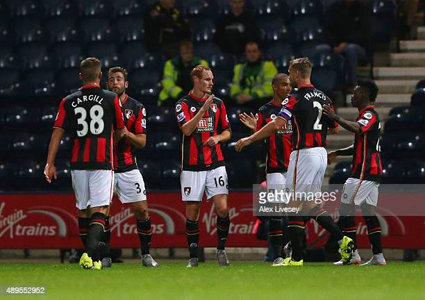 Shaun MacDonald of Bournemouth celebrates with team mates as he scores their first goal during the Capital One Cup third round match between Preston...