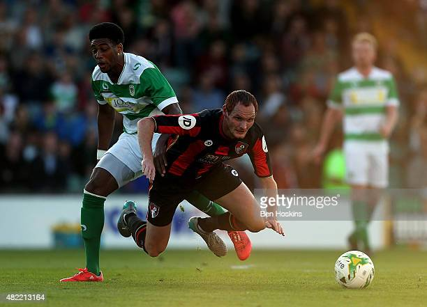 Shaun MacDonald of Bournemouth is fouled by Shaun Jeffers of Yeovil during a Pre Season Friendly between Yeovil Town and AFC Bournemouth at Huish...