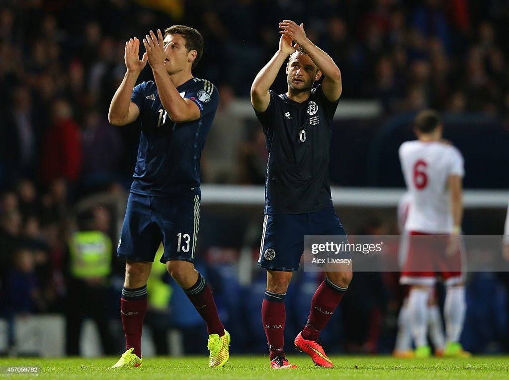 Shaun Maloney and Chris Martin of Scotland applaud their supporters after the EURO 2016 Qualifier match between Scotland and Georgia at Ibrox Stadium on October 11, 2014 in Glasgow, Scotland.