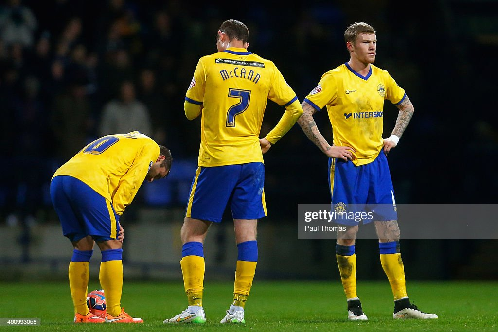 Shaun Maloney, Chris McCann and James McClean of Wigan react after going a goal behind during the FA Cup Third Round match between Bolton Wanderers and Wigan Athletic at the Macron Stadium on January 3, 2015 in Bolton, England.