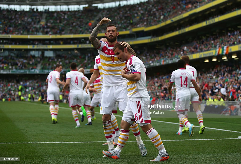 Shaun Maloney of Scotland celebrates his goal with Steven Fletcher during the UEFA EURO 2016 Qualifier Group D match between Republic of Ireland and Scotland at Aviva Stadium on June 13, 2015 in Dublin, Ireland.