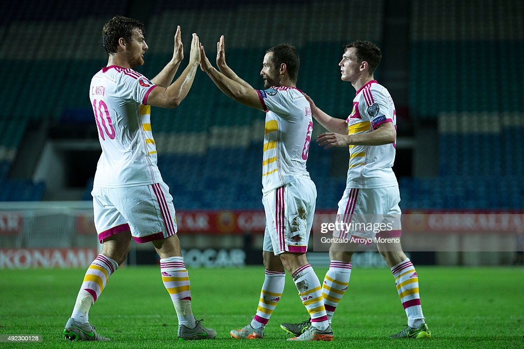 Shaun Maloney (2ndR) of Scotland celebrates scoring their second goal with teammates Chris Martin (L) and Andrew Robertson (R) during the UEFA EURO 2016 Qualifying round Group G match between Gibraltar and Scotland at Estadio Algarve on October 11, 2015 in Faro, Portugal.