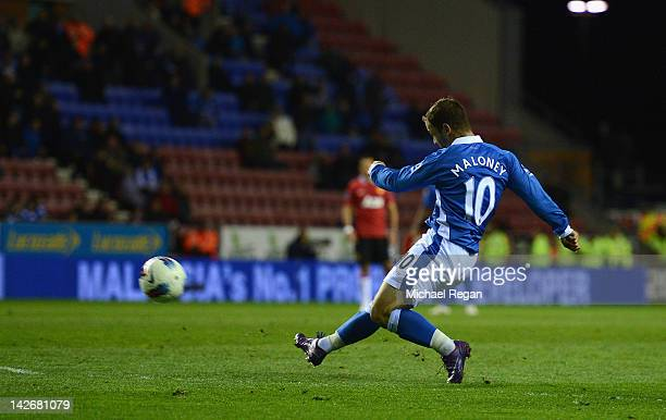 Shaun Maloney of Wigan scores to make it 10 during the Barclays Premier League match between Wigan Athletic and Manchester United at the DW Stadium...