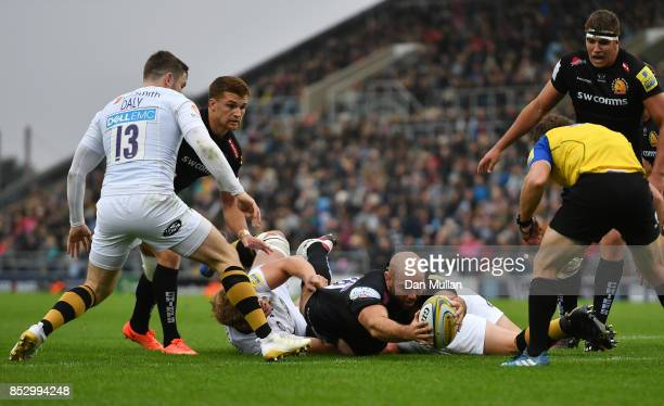 Shaun Malton of Exeter Chiefs dives over to score his side's fourth try during the Aviva Premiership match between Exeter Chiefs and Wasps at Sandy...