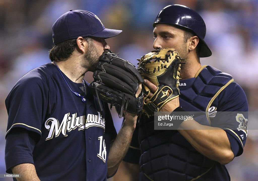 Shaun Marcum #18 and George Kottaras #9 of the Milwaukee Brewers talks as they walk to the dugout during an interleague game against the Kansas City Royals at Kauffman Stadium on June 14, 2012 in Kansas City, Missouri.