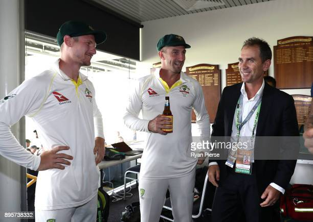 Shaun Marsh and Cameron Bancroft of Australia and former Australian Test Cricketer Justin Langer celebrate in the changerooms after Australia...