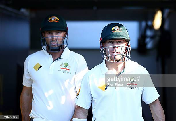 Shaun Marsh and David Warner of Australia walk out to open the batting during day one of the First Test match between Australia and South Africa at...