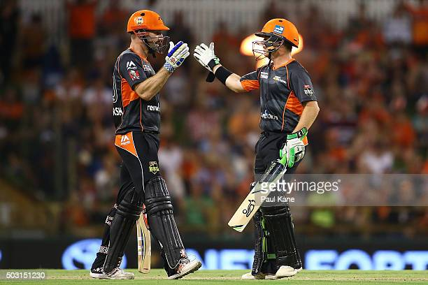 Shaun Marsh and Marcus Harris of the Scorchers celebrate winning the Big Bash League match between Perth Scorchers and Sydney Sixers at WACA on...