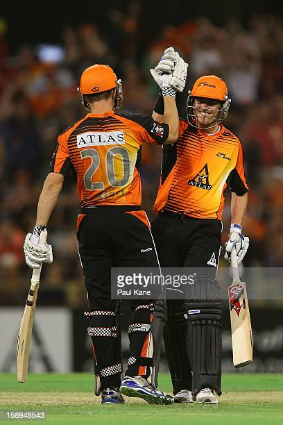 Shaun Marsh and Marcus North of the Scorchers celebrate winning the Big Bash League match between the Perth Scorchers and the Sydney Thunder at WACA...