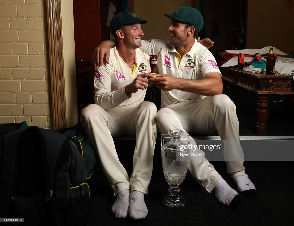 Shaun Marsh and Mitch Marsh of Australia celebrate with the Ashes Urn in the changreooms during day five of the Fifth Test match in the 2017/18 Ashes Series between Australia and England at Sydney Cricket Ground on January 8, 2018 in Sydney, Australia.
