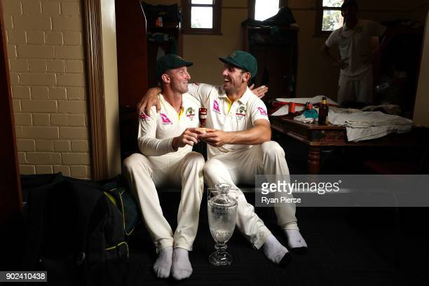 Shaun Marsh and Mitch Marsh of Australia celebrate with the Ashes Urn in the changreooms during day five of the Fifth Test match in the 2017/18 Ashes...