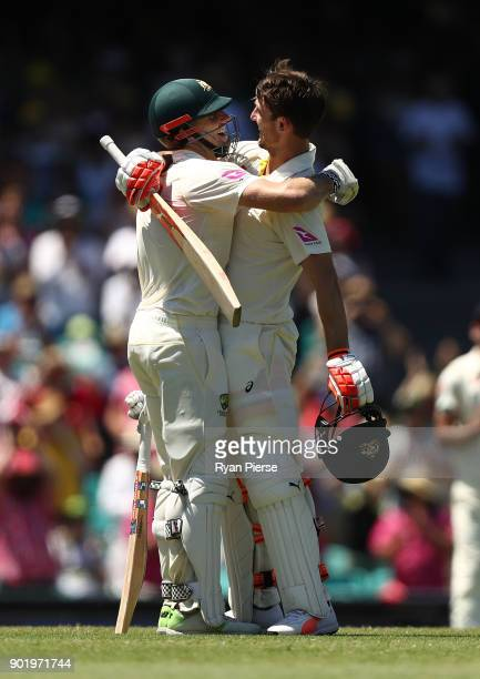 Shaun Marsh and Mitch Marsh of Australia celebrates after Mitch Marsh reached his century during day four of the Fifth Test match in the 2017/18...