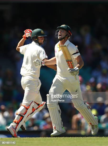 Shaun Marsh and Mitch Marsh of Australia celebrates after Shaun Marsh reached his century during day four of the Fifth Test match in the 2017/18...