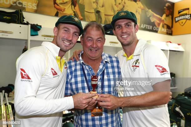 Shaun Marsh and Mitch Marsh of Australia pose with their father and former Australian Test Cricketer Geoff Marsh as they celebrate in the changerooms...