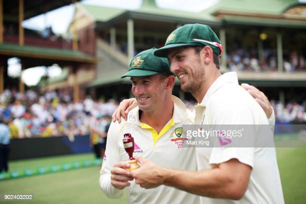 Shaun Marsh and Mitchell Marsh of Australia celebrate winning the Ashes during day five of the Fifth Test match in the 2017/18 Ashes Series between...