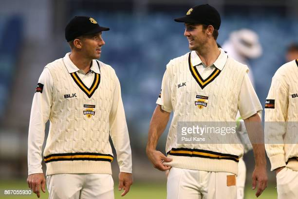 Shaun Marsh and Mitchell Marsh of Western Australia talk while walking from the field during day two of the Sheffield Shield match between Western...
