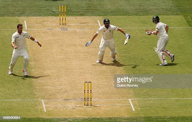 Shaun Marsh and Steve Smith of Australia get caught in the middle of the pitch as Marsh is run out by Brendon McCullum of New Zealand during day two...