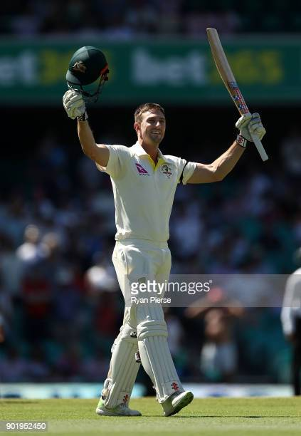 Shaun Marsh celebrates after reaching his century during day four of the Fifth Test match in the 2017/18 Ashes Series between Australia and England...
