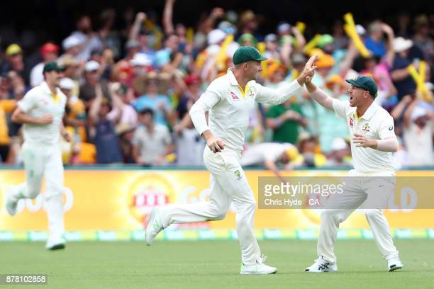 Shaun Marsh celebrates after taking a catch to dismiss Dawid Malan of England off the bowling of Mitchell Starc during day two of the First Test...