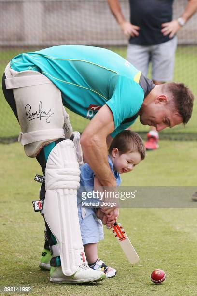 Shaun Marsh hits the ball with son Austin during the Australian nets session at the on December 25 2017 in Melbourne Australia
