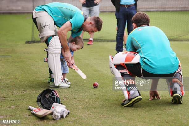 Shaun Marsh hits the ball with son Austin with brother Mitch Marsh who bowls it to them during the Australian nets session at the on December 25 2017...