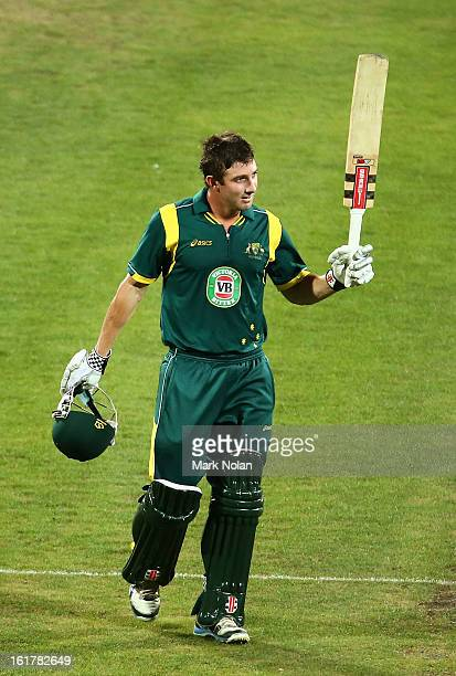 Shaun Marsh of Australia A Celebrates a century during the international tour match between Australia 'A' and the England Lions at Blundstone Arena...