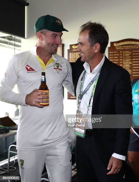 Shaun Marsh of Australia and former Australian Test Cricketer Justin Langer celebrate in the changerooms after Australia regained the Ashes during...