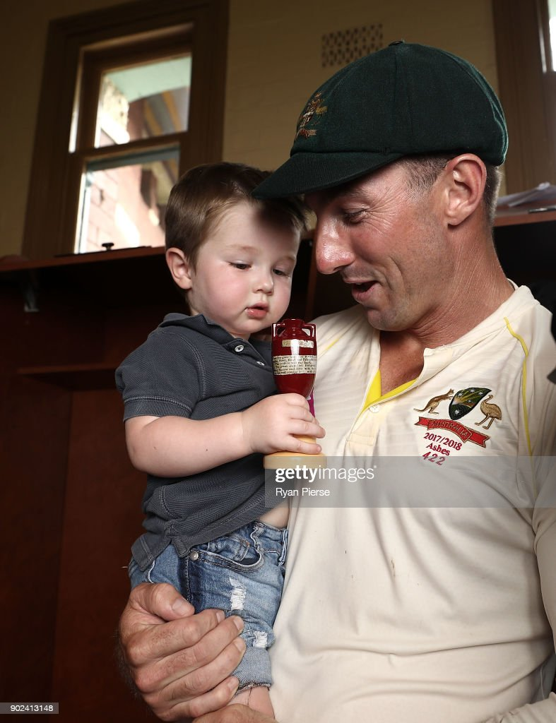 Shaun Marsh of Australia and his son Austin celebrate with the Ashes Urn during day five of the Fifth Test match in the 2017/18 Ashes Series between Australia and England at Sydney Cricket Ground on January 8, 2018 in Sydney, Australia.