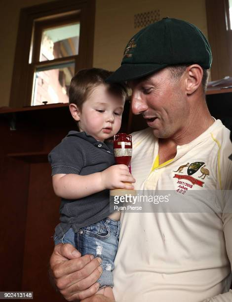 Shaun Marsh of Australia and his son Austin celebrate with the Ashes Urn during day five of the Fifth Test match in the 2017/18 Ashes Series between...