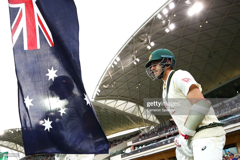 Shaun Marsh of Australia and Pat Cummins of Australia enter the field to bat during day two of the Second Test match during the 2017/18 Ashes Series between Australia and England at Adelaide Oval on December 3, 2017 in Adelaide, Australia.