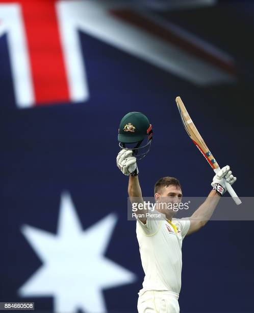 Shaun Marsh of Australia celebrates after reaching his century during day two of the Second Test match during the 2017/18 Ashes Series between...