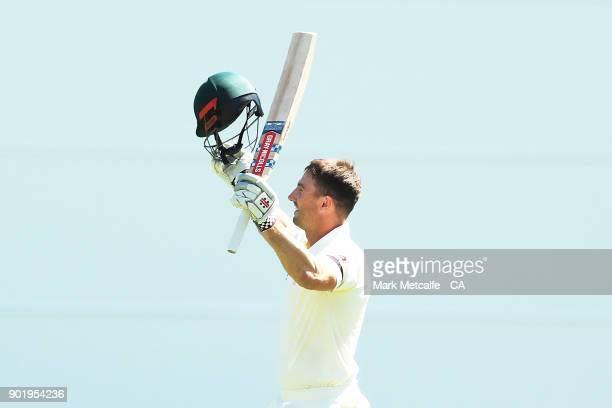 Shaun Marsh of Australia celebrates and acknowledges the crowd after scoring a century during day four of the Fifth Test match in the 2017/18 Ashes...