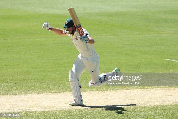 Shaun Marsh of Australia celebrates scoring a century during day four of the Fifth Test match in the 2017/18 Ashes Series between Australia and...