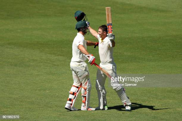 Shaun Marsh of Australia celebrates with his brother Mitch Marsh of Australia after reaching his century during day four of the Fifth Test match in...