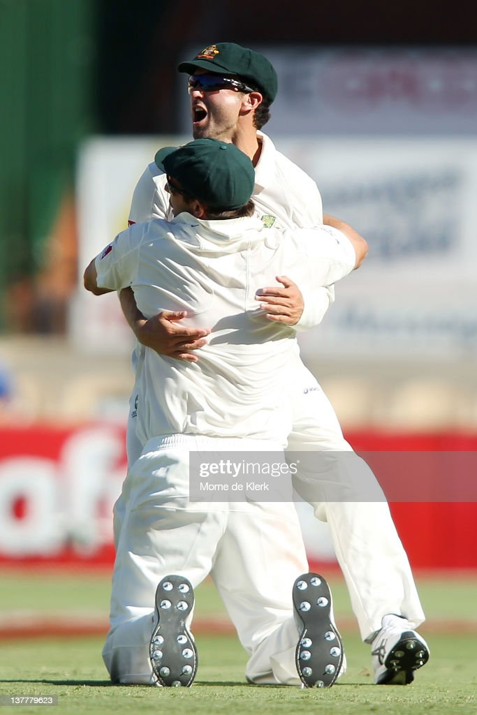 Shaun Marsh of Australia celebrates with team mate Ben Hilfenhaus after Hilfenhaus ran out Virat Kohli of India during day four of the Fourth Test Match between Australia and India at Adelaide Oval on January 27, 2012 in Adelaide, Australia.