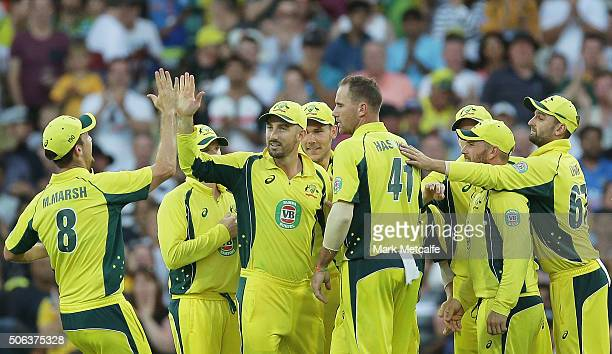 Shaun Marsh of Australia celebrates with team mates after taking the wicket of Shikhar Dhawan of India during game five of the Commonwealth Bank One...