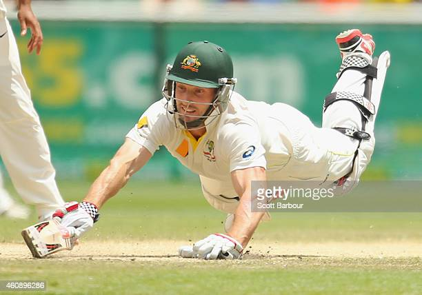 Shaun Marsh of Australia dives for his ground but is run out for 99 runs during day five of the Third Test match between Australia and India at...