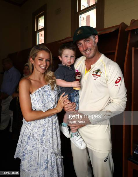 Shaun Marsh of Australia his wife Rebecca Marsh and their son Austin pose with the Ashes Urn in the change rooms after day five of the Fifth Test...