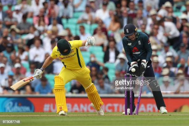 Shaun Marsh of Australia is bowled by Moeen Ali of England as wicket keeper Jos Buttler gathers the ball during the 1st Royal London ODI between...
