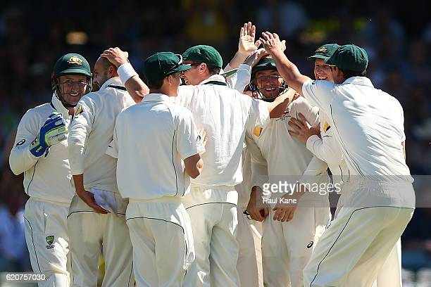 Shaun Marsh of Australia is congratulated by team mates after taking a catch to dismiss Temba Bavuma of South Africa during day one of the First Test...