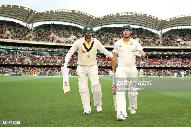 Shaun Marsh of Australia leaves the field not out on 125 with team mate Nathan Lyon of Australia as Australia declare during day two of the Second...