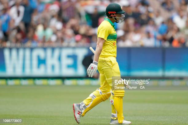 Shaun Marsh of Australia walks from the field after being dismissed during game three of the One Day International series between Australia and India...