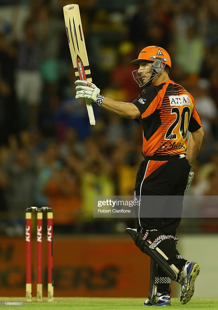 Shaun Marsh of the Perth Scorchers celebrates scoring his half century during the Big Bash League semi-final match between the Perth Scorchers and the Melbourne Stars at the WACA on January 16, 2013 in Perth, Australia.