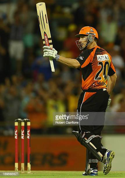 Shaun Marsh of the Perth Scorchers celebrates scoring his half century during the Big Bash League semifinal match between the Perth Scorchers and the...