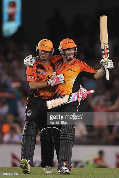 Shaun Marsh of the Scorchers celebrates hitting the winning runs with team mate Luke Ronchi during the T20 Big Bash League match between the...